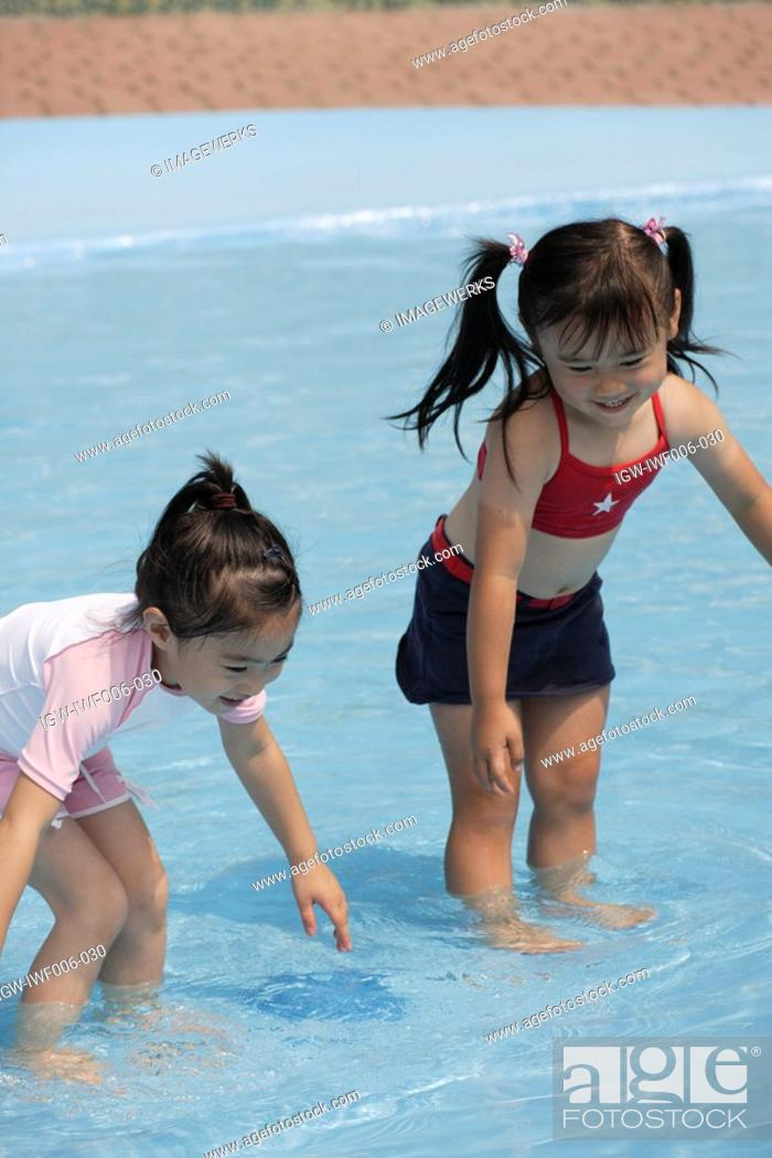 Stock Photo: Two girls in pool.