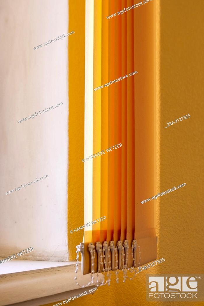Stock Photo: Orange vertical window blinds.