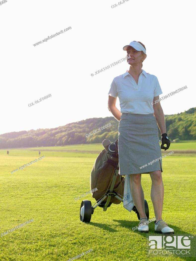 Stock Photo: Woman at fairway.