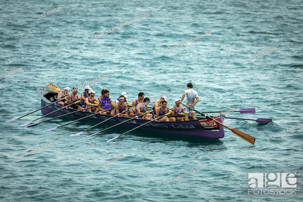 Stock Photo: CASTRO URDIALES, SPAIN - JULY 15, 2018: Competition of boats, regata of trainera, San Pedro, Libia boat in action in the VI Bandera CaixaBank competition.