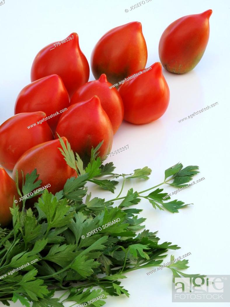 Stock Photo: Tomatoes and parsley.
