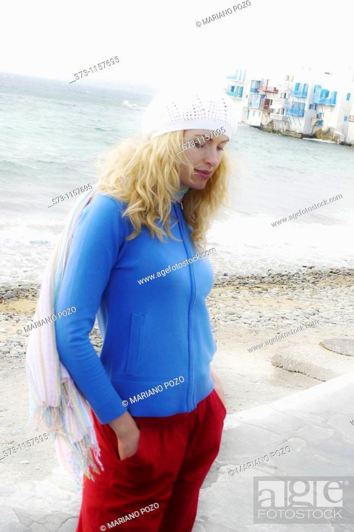 Stock Photo: 30 years old woman in Little Venice, Mykonos, Cyclades Islands, Greece.