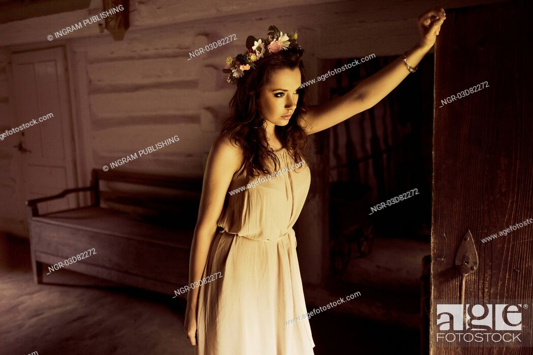 Stock Photo: Flower princess in the old wooden house.