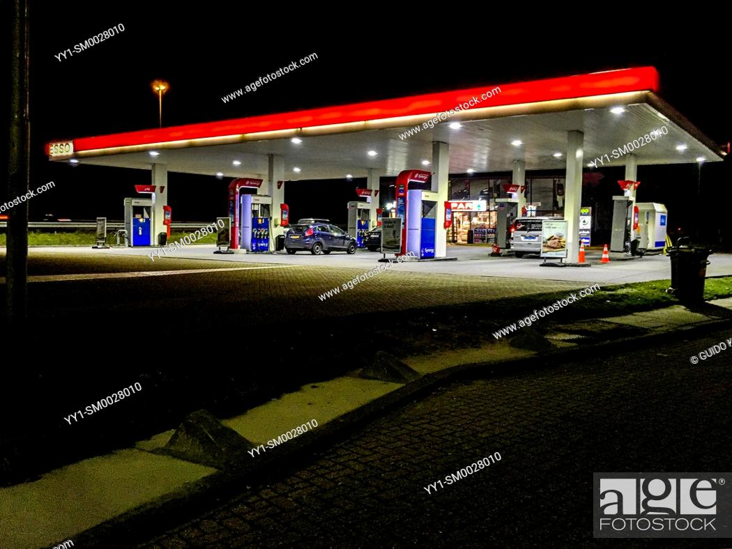 Stock Photo: Noord-Brabant, Netherlands. Gas and Fuel Station Alonside Highway at Night.