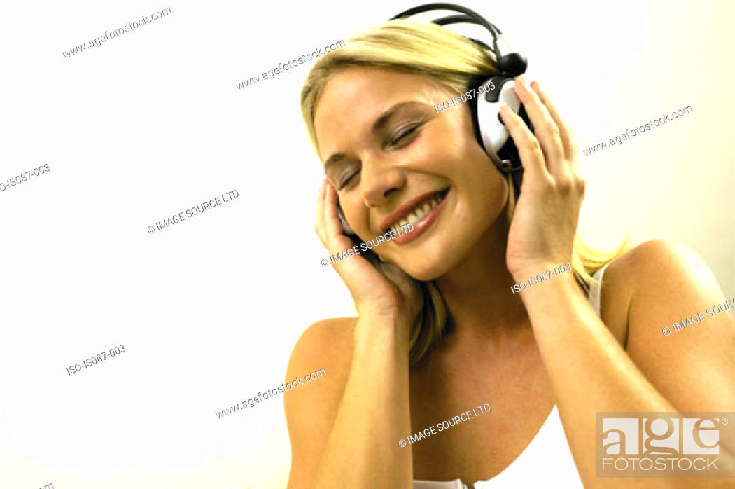 Stock Photo: Girl listening to music.