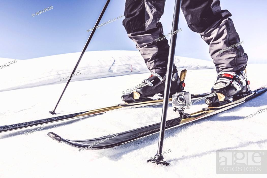 Stock Photo: Close-up of skier with action cam in winter landscape.