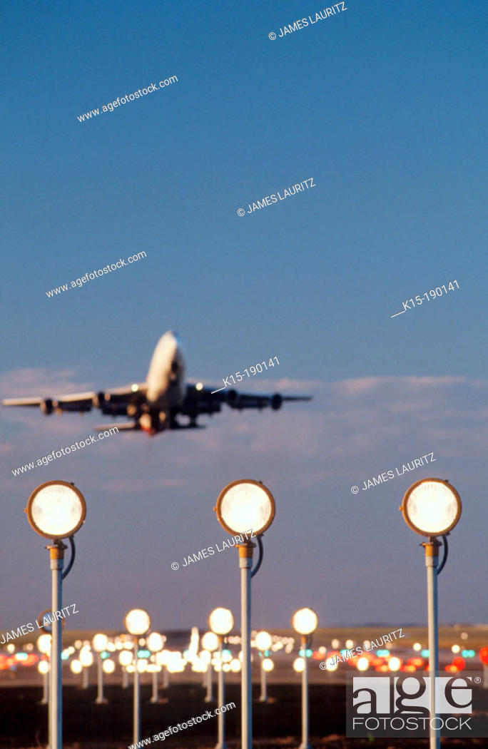 Boeing 747 taking off with runway landing lights in