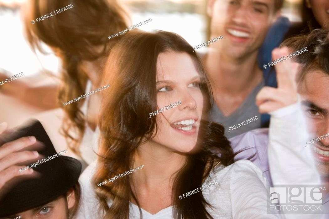 Stock Photo: Woman smiling with her friends beside her.