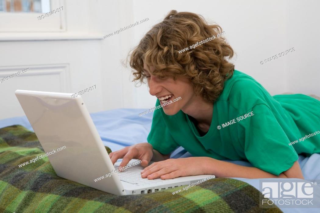 Stock Photo: Teenage boy using laptop.
