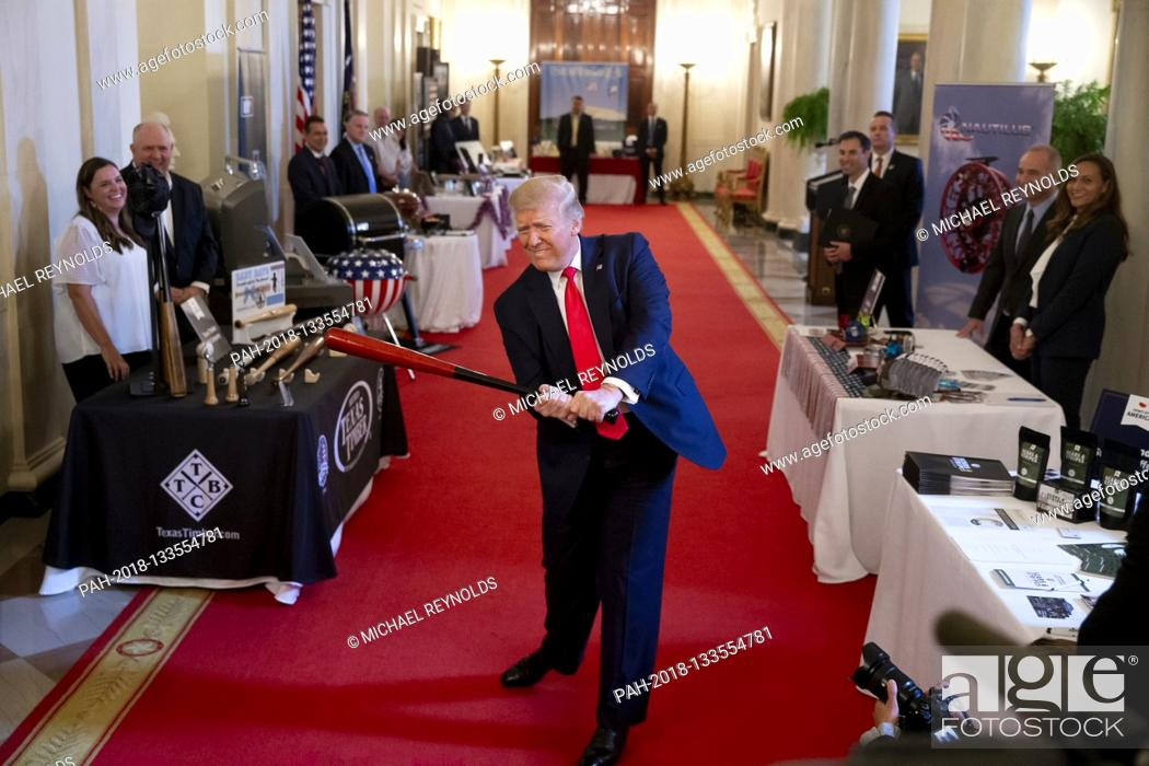 Photo de stock: US President Donald J. Trump swings a baseball bat made by Texas Timber Bat Company, while participating in the 'Spirit of America Showcase'.