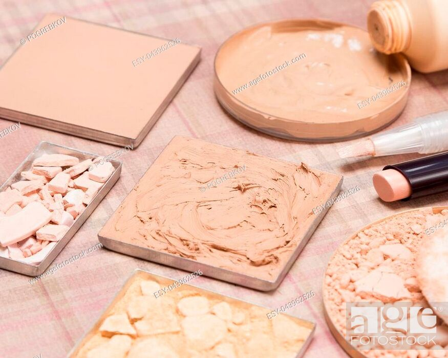 Stock Photo: Basic makeup products to create beautiful skin tone and complexion: concealers, cream-to-powder and liquid foundation, shimmer powder golden color.