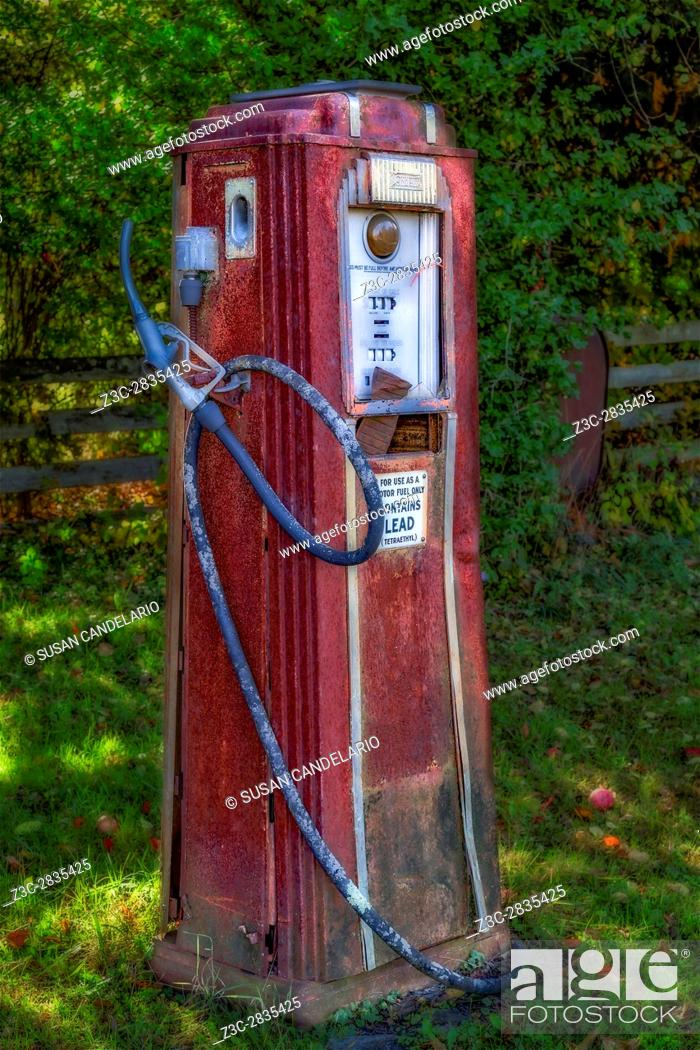 Stock Photo: Vintage Tokheim Gas Pump - Abandoned and rusted but still standing. Tokheim began in an Iowa hardware store more than a century ago.