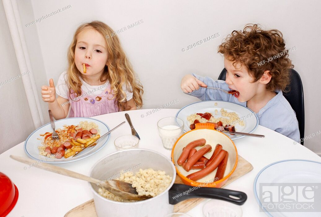 Stock Photo: Boy and girl at a dinner table, Sweden.