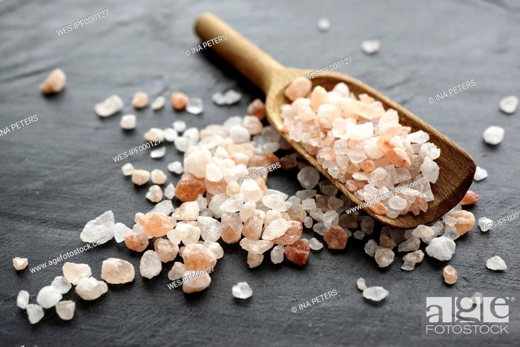 Stock Photo: Himalayan salt, Coarse salt on wooden spoon.