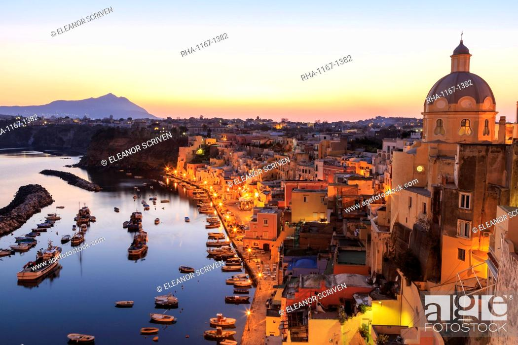 Stock Photo: Marina Corricella, blue hour after sunset, fishing village, colourful houses, boats and church, Procida, Bay of Naples, Campania, Italy, Europe.