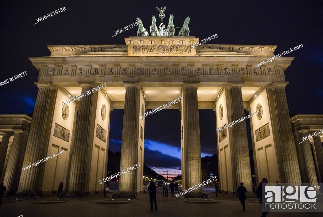 Stock Photo: Moody sky behind the Brandenburg Gate at night in Berlin, Germany.