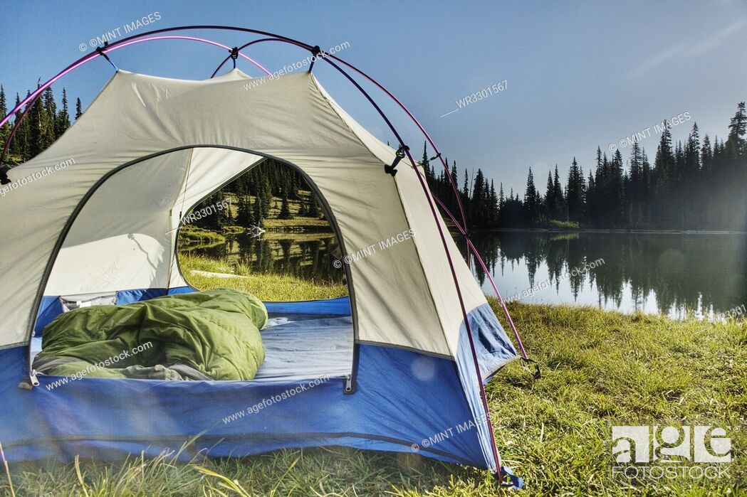 Stock Photo: Tent at tranquil lakeside.
