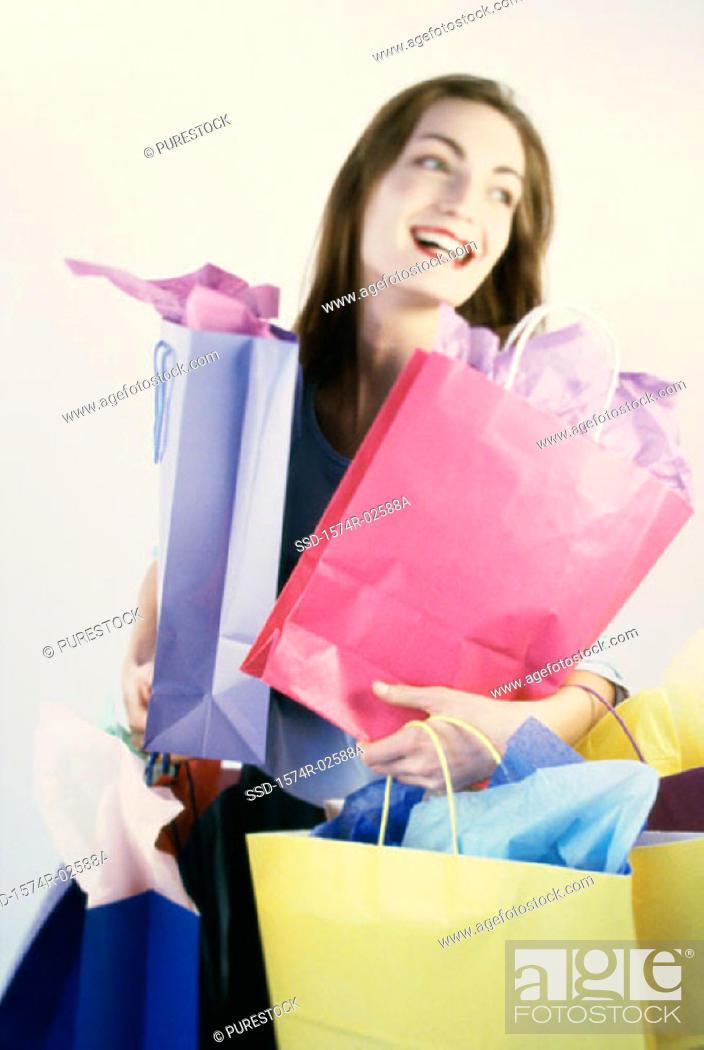 Stock Photo: Young woman carrying shopping bags.