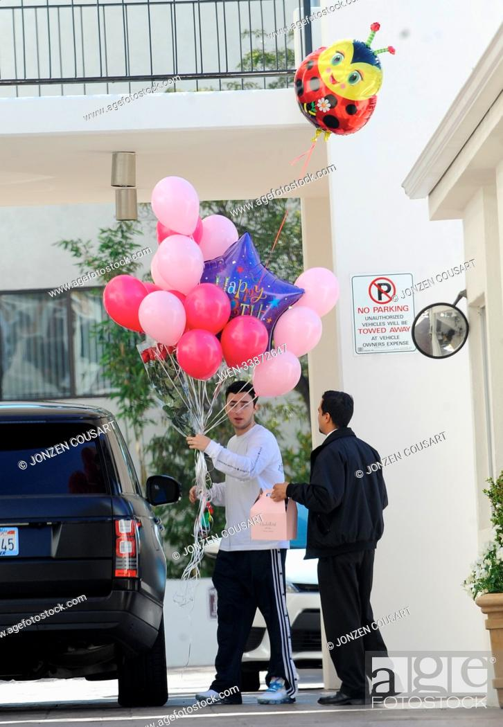 Of Model Madison Beer Holding A Handful Balloons Roses And Huge Birthday Card For Her 19th Featuring Zack Bia Where Los Angeles