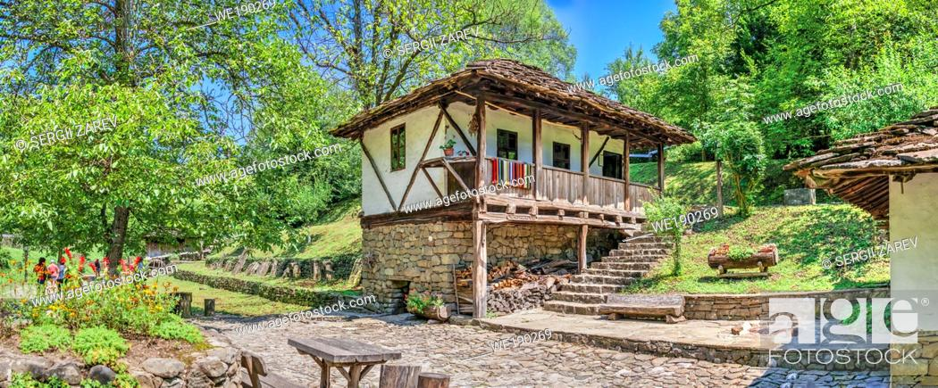 Stock Photo: Old traditional house in the Etar Architectural Ethnographic Complex in Bulgaria on a sunny summer day. Big size panoramic photo.