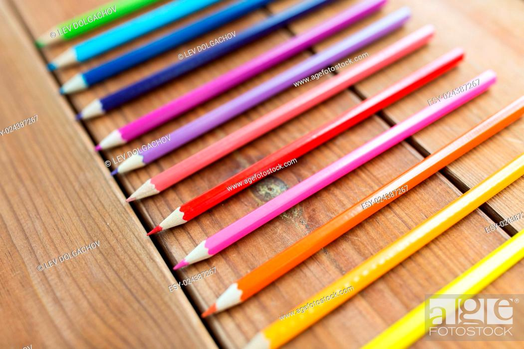 Stock Photo: art, color, drawing, creativity and object concept - close up of crayons or color pencils on wooden table.