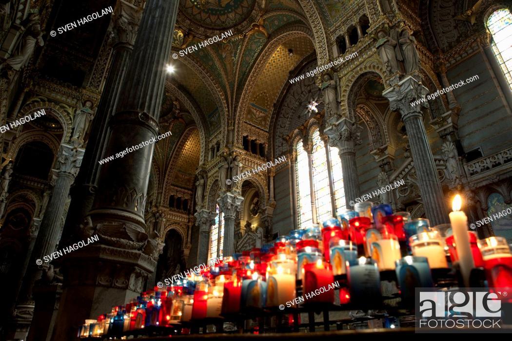 Stock Photo: Lit votive candles in the Basilica Notre Dame De Fourviere, Lyon France.
