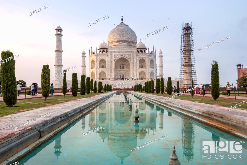 Stock Photo: The reflex of Taj Mahal in the water in a hot summer afternoon. Agra, Uttar Pradesh. India.