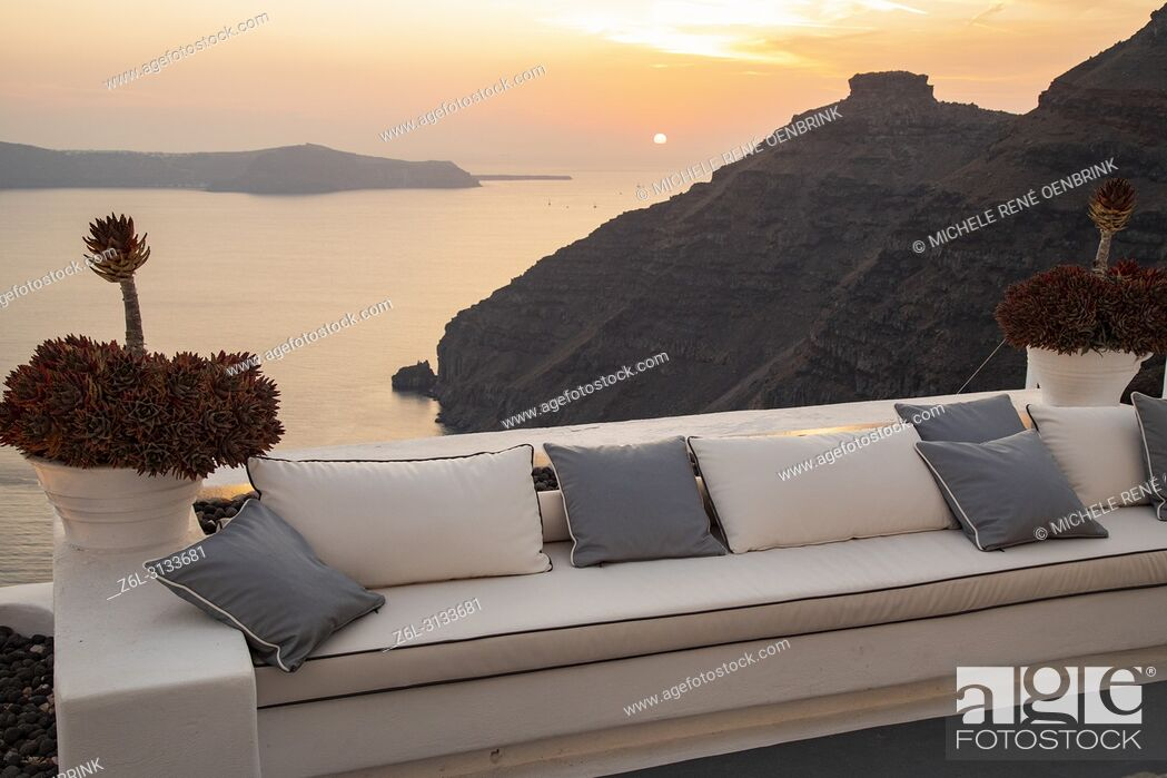 Stock Photo: Comfortable couch overlooking the caldera sunset view in Thira, Fira, Santorini Greece.