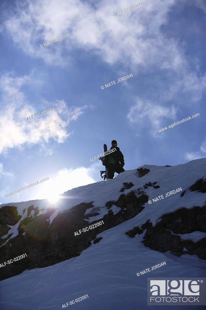 Stock Photo: Snowboarder Standing on Mountain.