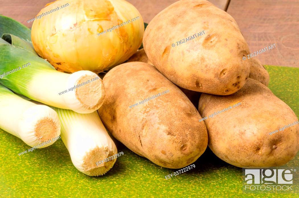 Stock Photo: Leeks and potatoes on a cutting board to make leek soup.