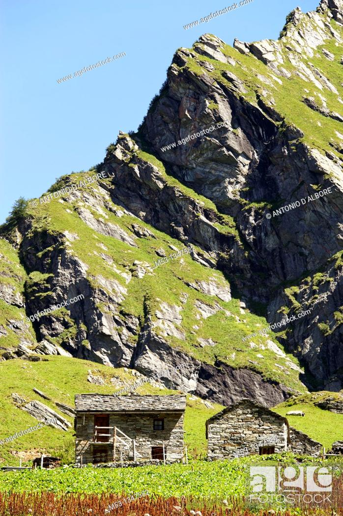 Stock Photo: Impressive mountain landscape with traditional huts at Alpe Campo  1923 meters  Pennine Alps  Valsesia  province of Vercelli  Piemonte  Italy.
