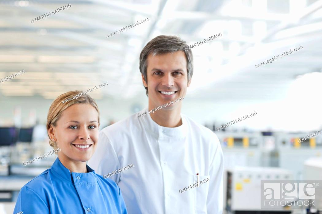 Stock Photo: Scientists smiling together in lab.