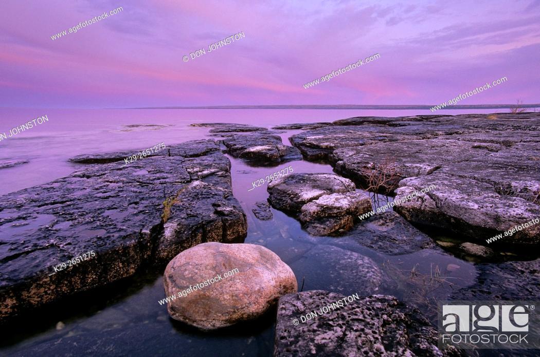 Stock Photo: Dawn skies and shoreline limestones at Mississagi Point, Mississagi Lighthouse, Manitoulin Island, Ontario, Canada.