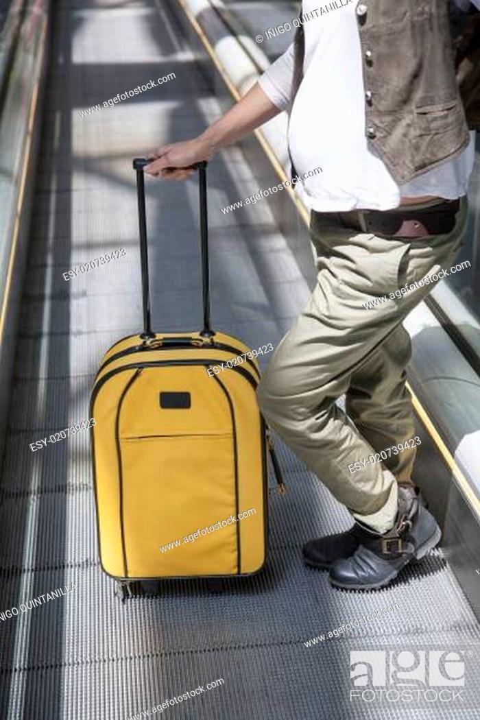 Stock Photo: pregnant with suitcase at walkway.