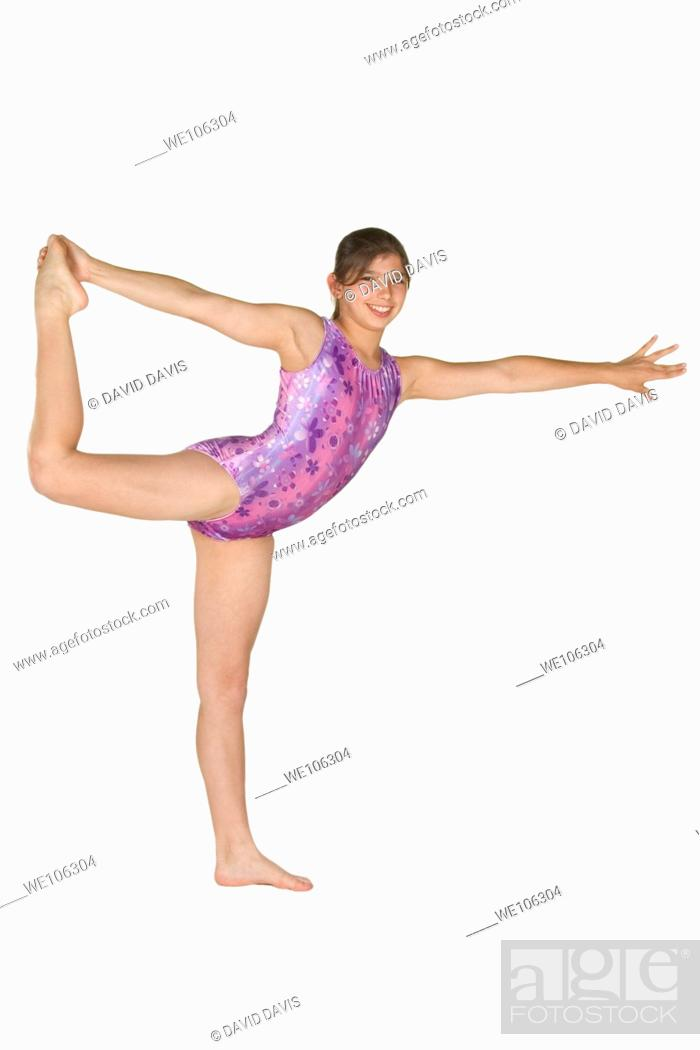 Stock Photo: 12 year old caucasian girl in gymnastics poses.