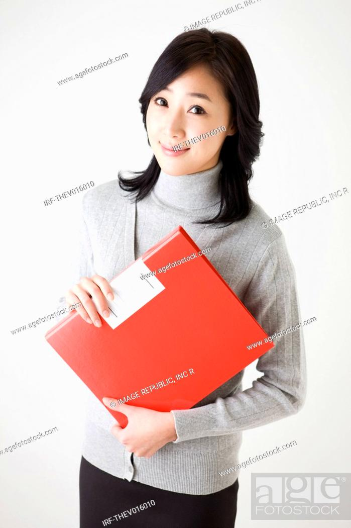 Stock Photo: businesswoman holding a profile.