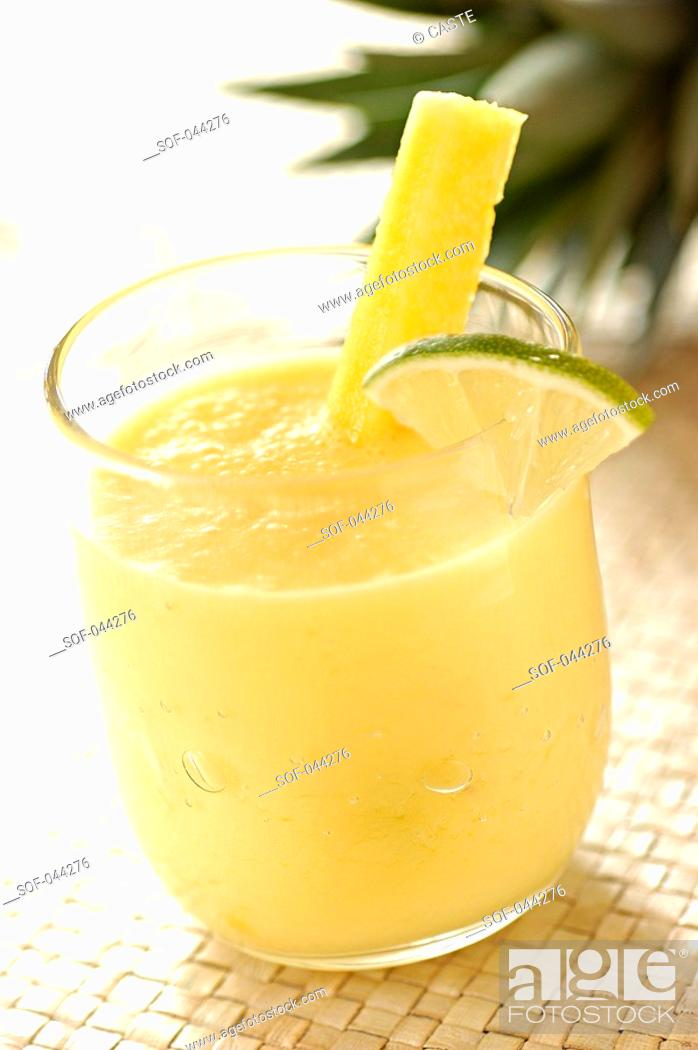 Stock Photo: pineapple, lime and coconut smoothie.