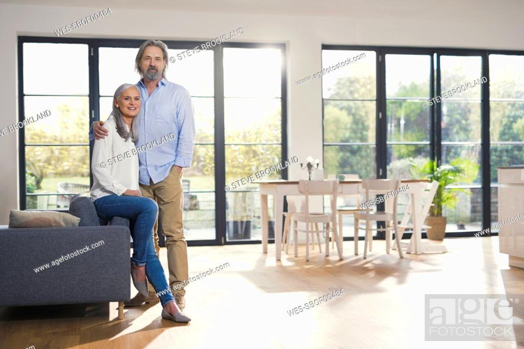 Stock Photo: Senior couple standing in their comfortable loving room.