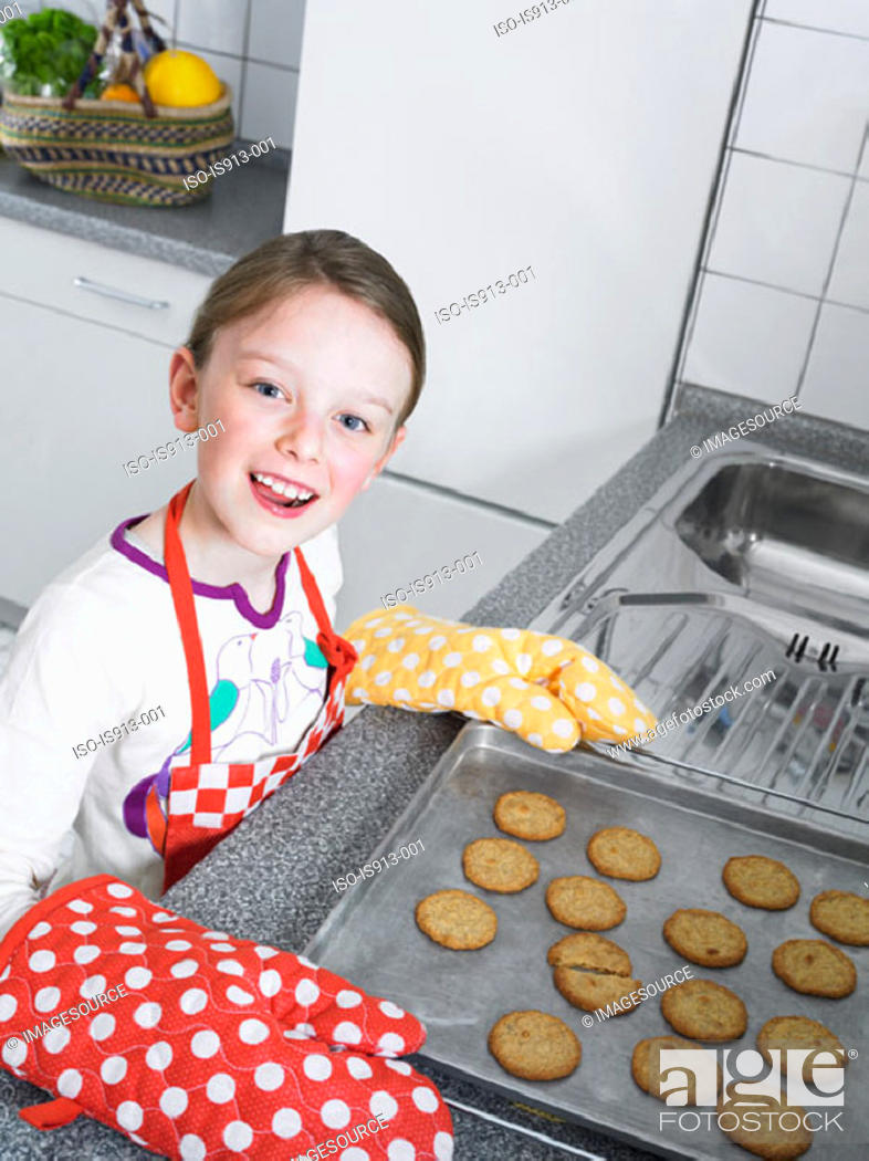 Stock Photo: Girl baking biscuits.