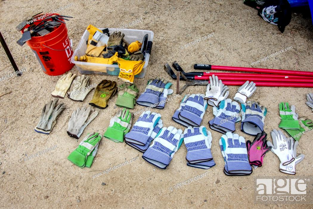 Stock Photo: Gloves and gardening tools are laid out for the weeding group at a Girl Scout nature demonstration in Newport Beach, CA.