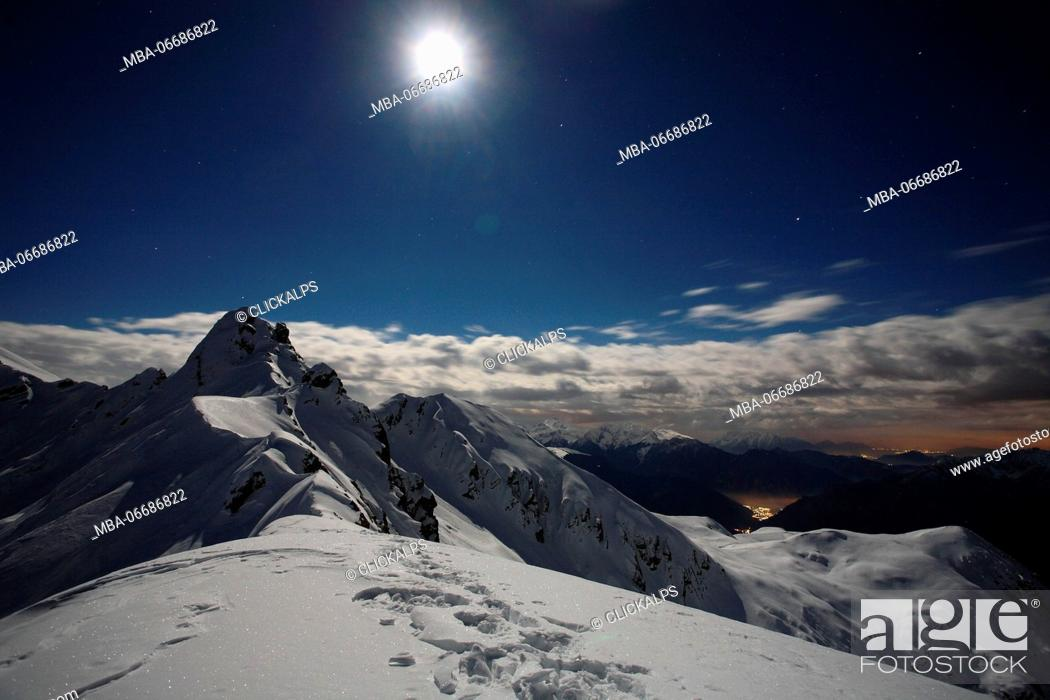 Stock Photo: Full moon at Salmurano mountain on the Orobie alps, Lombardy, italy.