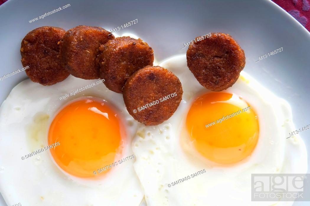 Stock Photo: Fried eggs with farinato, traditional dish of Ciudad Rodrigo. Salamanca. Castilla y León. Spain. Europe.