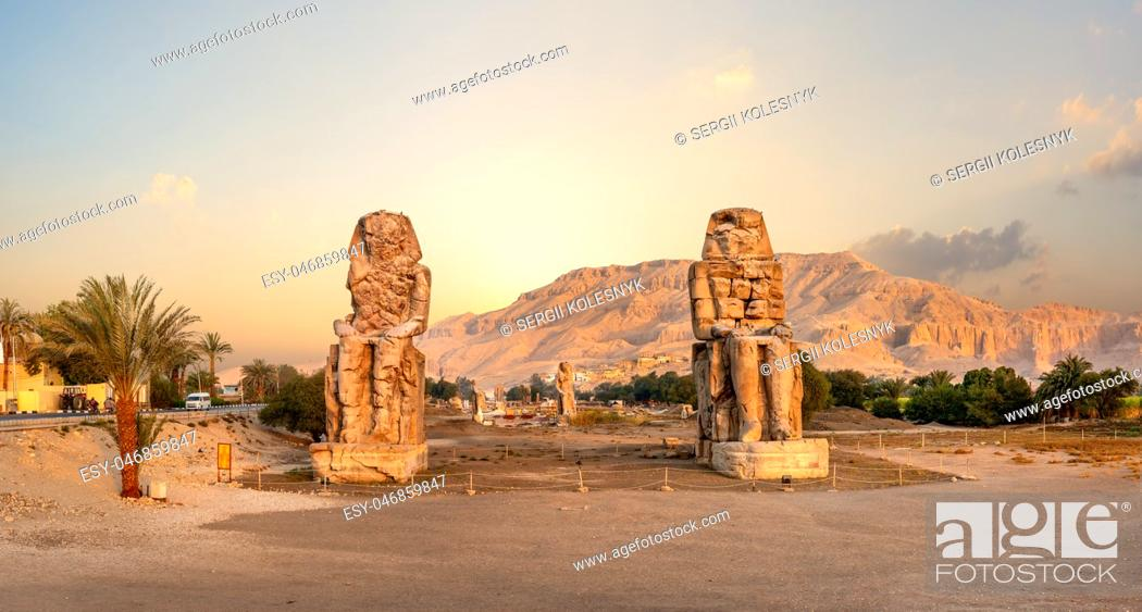 Stock Photo: Egypt. Luxor. The Colossi of Memnon - two massive stone statues of Pharaoh Amenhotep.