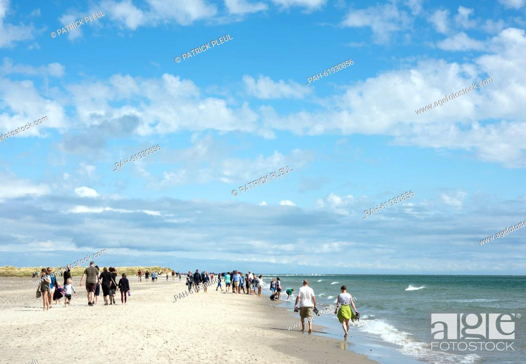 Stock Photo: Tourists on the beach of Denmark's northernmost tip where the North Sea(from the left) and the Baltic Sea (from the right) encounter in Grenen, Germany.