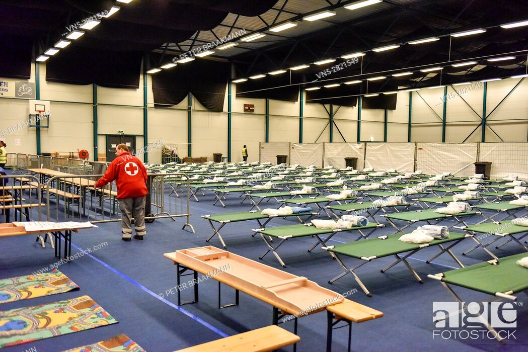 Stock Photo: ROOSENDAAL - THE NETHERLANDS - OCTOBER 2: Sports hall for the reception of 200 refugees in the Netherlands on October 2, 2015.