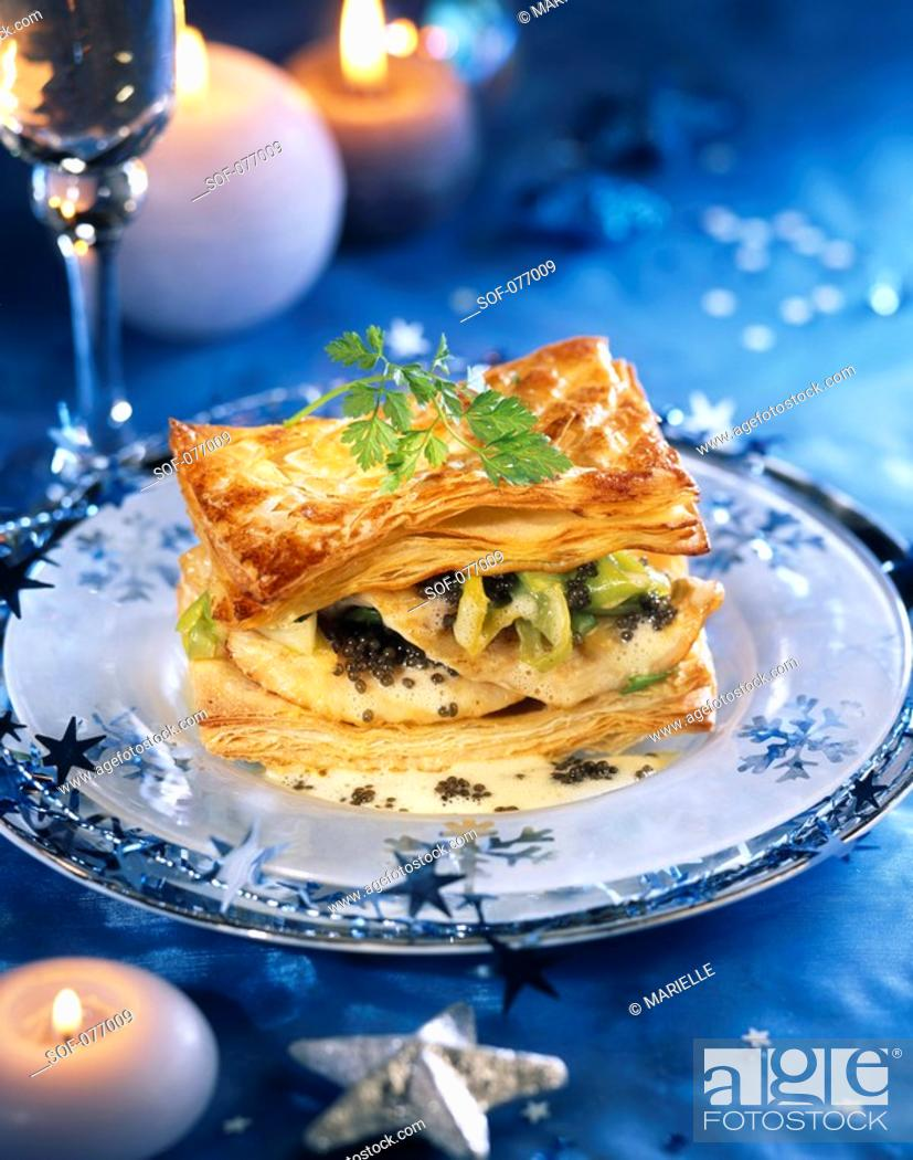 Stock Photo: John Dory fish in flaky pastry with caviar and champenoise sauce.