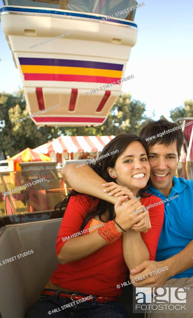 Photo de stock: Couple riding a Ferris wheel together.