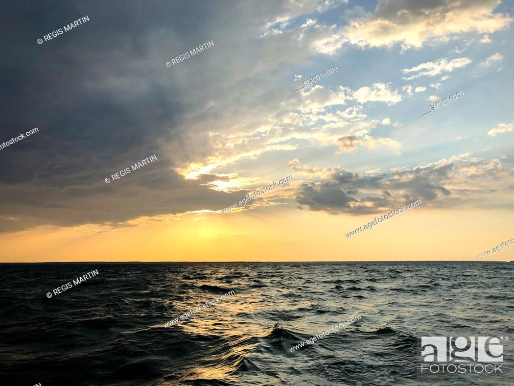 Stock Photo: Sunset over the ocean.
