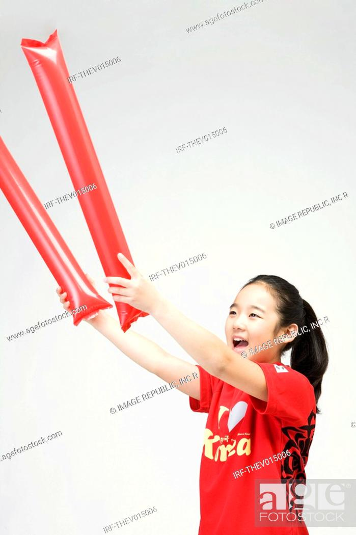 Stock Photo: girl holing balloon stick.