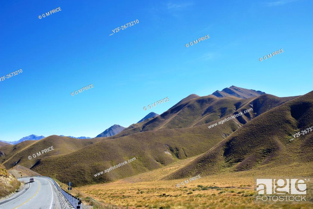 Stock Photo: winding road through Lindis Pass, Canterbury, New Zealand.